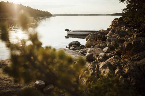 Motorboat left at rocky shore of Bergholmarna island - SAJF00085