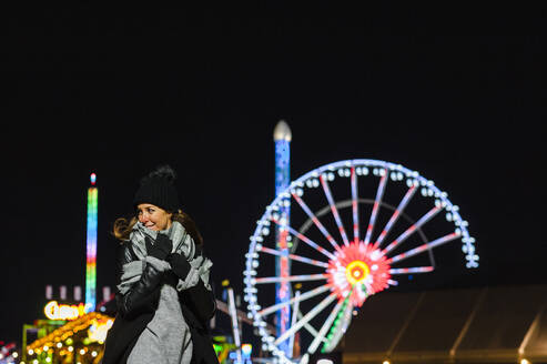 Woman in winter on fairground - JMPF00370