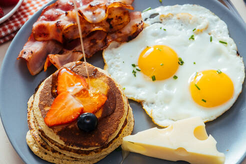 Delicious fried eggs with bacon and cheese for breakfast - ADSF13165