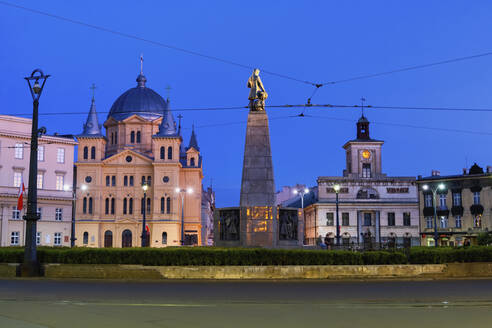 Poland, Lodz, Power lines over Freedom Square with Church of Pentecost of Holy Spirit, Kosciuszko Monument and town hall in background - ABOF00547