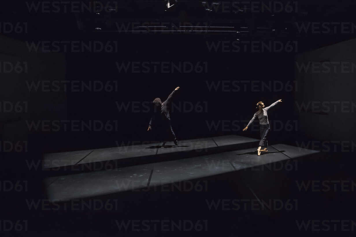 Male and female dancer performing comtemporary ballet on black stage - NGF00607 - Nadine Ginzel/Westend61