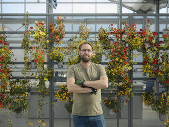 Portrait of a confident man in a greenhouse - JOSEF01576