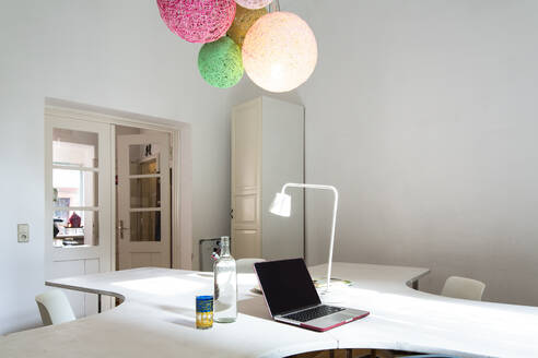 Laptop on table in modern home office - FKF03821