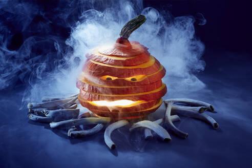 Studio shot of spooky jack-o-lantern made of red kuri squash - SRSF00670