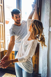 Young couple in casual clothing caught in moment of dance. - EHF00955
