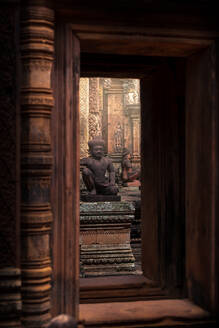 Historic stone statues in Banteay Srei Buddhist temple located in Cambodia - ADSF15393
