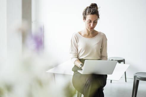 Businesswoman working over laptop - JOSEF01892