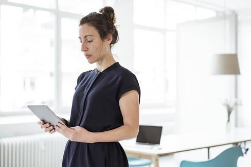 Female entrepreneur using digital tablet - JOSEF01940