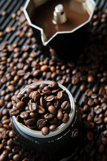 Coffee in coffee pot and coffee beans on the table - ADSF15641