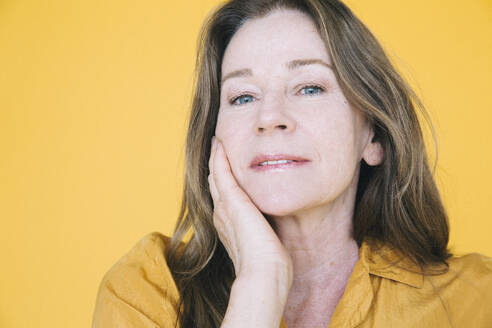 Portrait of senior woman against yellow background - MASF19825