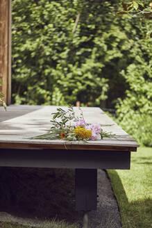 Flowers on wooden floor in porch - MCF01374
