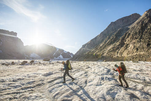 Two climber cross a glacier in Auyuittuq National Park - CAVF88804