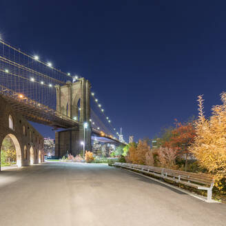 USA, New York, New York City, Brooklyn Bridge illuminated at night - AHF00043