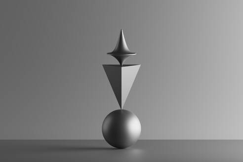 Metallic spinning whirligig balancing on top of a sphere and a pyramid, 3D Render - DRBF00210