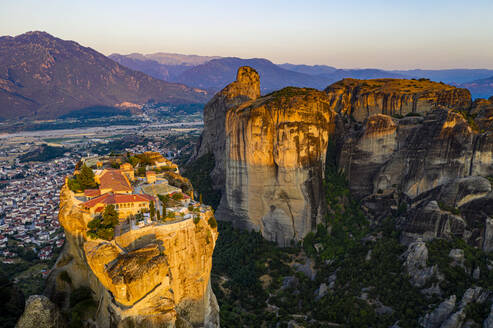 Aerial by drone of the Holy Monastery of Holy Trinity at sunrise, UNESCO World Heritage Site, Meteora Monasteries, Greece, Europe - RHPLF17683