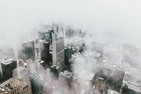 Aerial view highrise buildings in fog, Chicago, Illinois, USA - FSIF05170