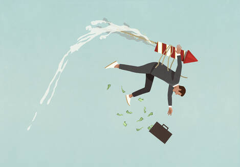 Businessman with rocket strapped to back falling from sky - FSIF05326