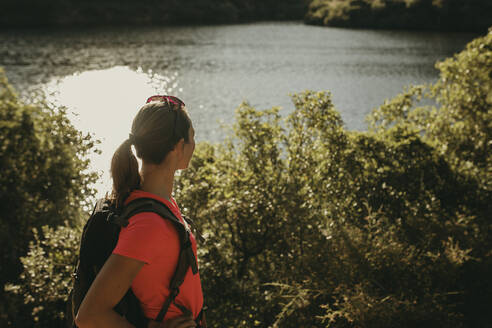 Trekker looking at view while standing at Sierra De Hornachuelos, Cordoba, Spain - DMGF00163