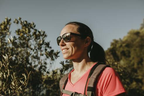 Mid adult woman standing at Sierra De Hornachuelos, Cordoba, Spain - DMGF00166