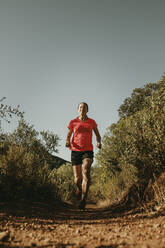 Woman running on footpath at Sierra De Hornachuelos, Cordoba, Spain - DMGF00172