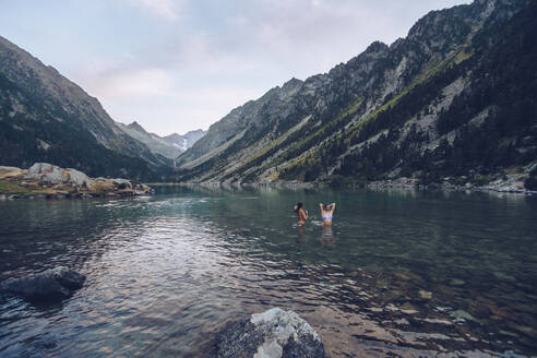 Young women taking bath in lake of Gaube - RSGF00377
