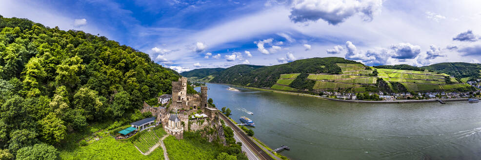 Germany, Rhineland-Palatinate, Trechtingshausen, Helicopter panorama of Rheinstein Castle and river Rhine in summer - AMF08569