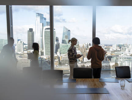 Business people talking at highrise office window, London, UK - CAIF29813