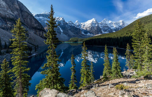 Magnificent scenery of beautiful lake with clean plain water reflecting rocky mountains and green forest in sunny day in Duffey Lake Provincial Park in Canada - ADSF17047