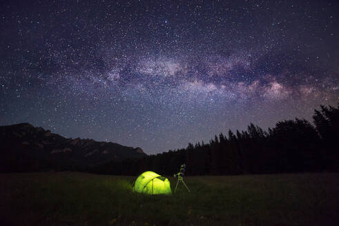 Camping tent at night against amazing sky full of stars and milky-way - CAVF89783