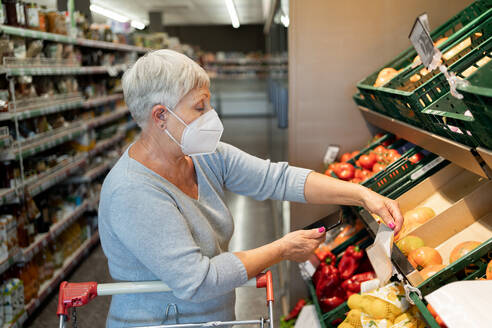 Caucasian elderly woman with white hair shopping in supermarket - CAVF89973