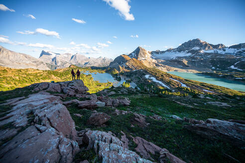 Couple Holding Hands During Sunset Surrounded by Mountains in Rockies - CAVF90104
