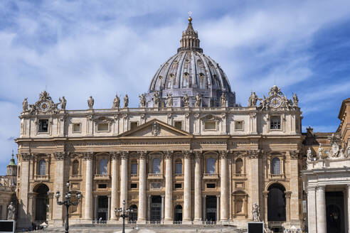 Facade of St. Peter's Basilica in city, Vatican City, Rome, Italy - ABOF00570