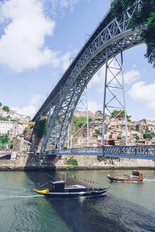 Dom Luis I Bridge over Douro River against sky, Porto, Portugal - RSGF00392