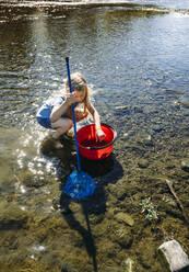Little girl fishing in Edersee reservoir - IPF00569