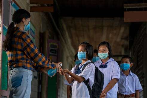 Teacher wearing protective mask to Protect Against Covid-19 and - CAVF90521