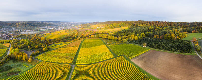 Germany, Baden Wurttemberg, Remstal, Drone view of countryside town at foggy dawn - STSF02665