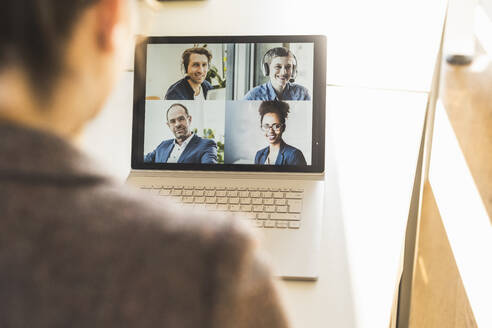 Businesswoman attending video conference on laptop at office - UUF22159