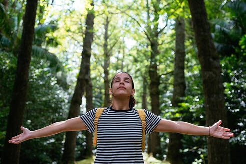 Young woman enjoying in nature - CAVF91266