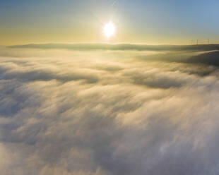 Germany, Baden-Wurttemberg, Drone view of Remstal valley shrouded in thick fog at sunrise - STSF02710
