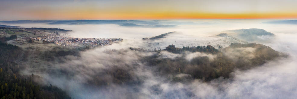 Germany, Baden-Wurttemberg, Berglen, Drone view of village shrouded in thick fog at dawn - STSF02735