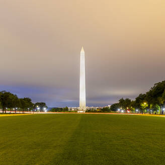 USA, Washington DC, Cloudy sky over lawn in front of Washington Monument at dusk - AHF00211