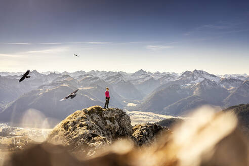 Sportswoman looking at view while standing on Aggenstein mountain at Bavaria, Germany - MALF00336