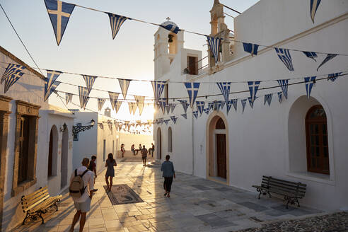 Sunset in Plaka, the main town on Milos island, with Greek Orthodox feast decoration on the church square with pebble mosaic, Plaka, Milos, Cyclades, Greek Islands, Greece, Europe - RHPLF18865