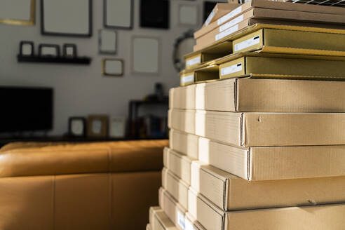 Stack of carton boxes at home - GIOF10255