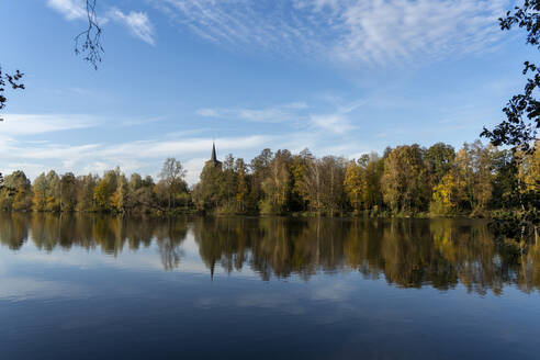 Scenic view of calm lake by trees against sky in forest - CHPF00741
