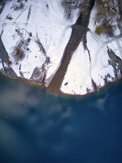 Aerial view of snow-covered shore of Lake Ritsa - KNTF06042
