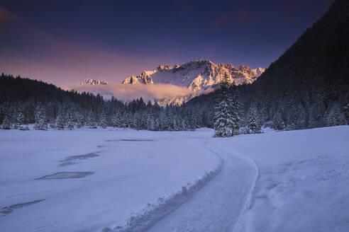 Scenic view of snow covered landscape against sky during sunset - MRF02406