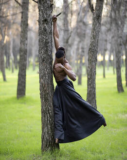 Professional dancer performing alone in middle of forest - JCCMF00613
