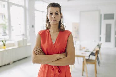 Portrait of businesswoman standing in office - GUSF05004