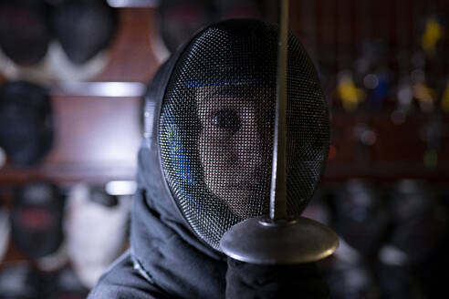 Womanin fencing mask at gym - JCCMF00723